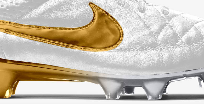 the nike tiempo legend ronaldinho shoes boast a white base while the swoosh and the soleplate have a golden metallic finish